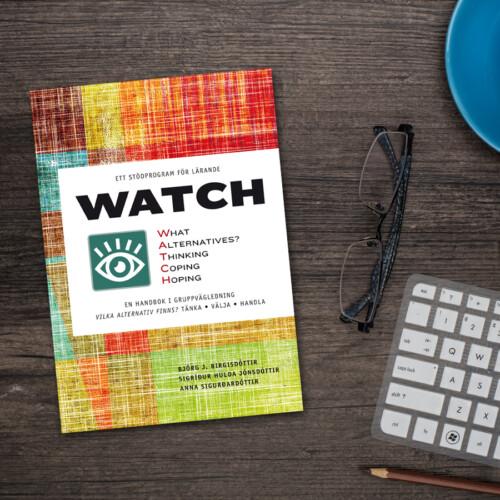 """Boken """"WATCH"""" på ett skrivbord"""